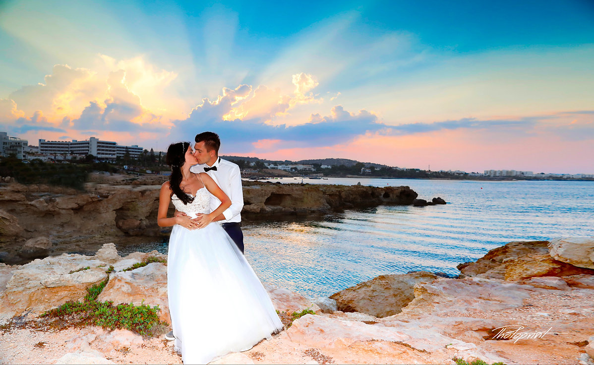 Bride and Groom, Kissing at Sunset on a Beautiful Mediterranean Beach Prrotaras Cyprus | cyprus wedding photographers prices protaras beach, getting married in Protaras for best photography