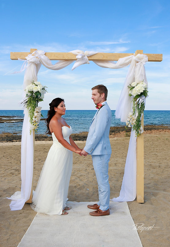 Side View wedding standing Atilla and Sandra by the beach Agia triada | best wedding photograph  Agia trada Protaras