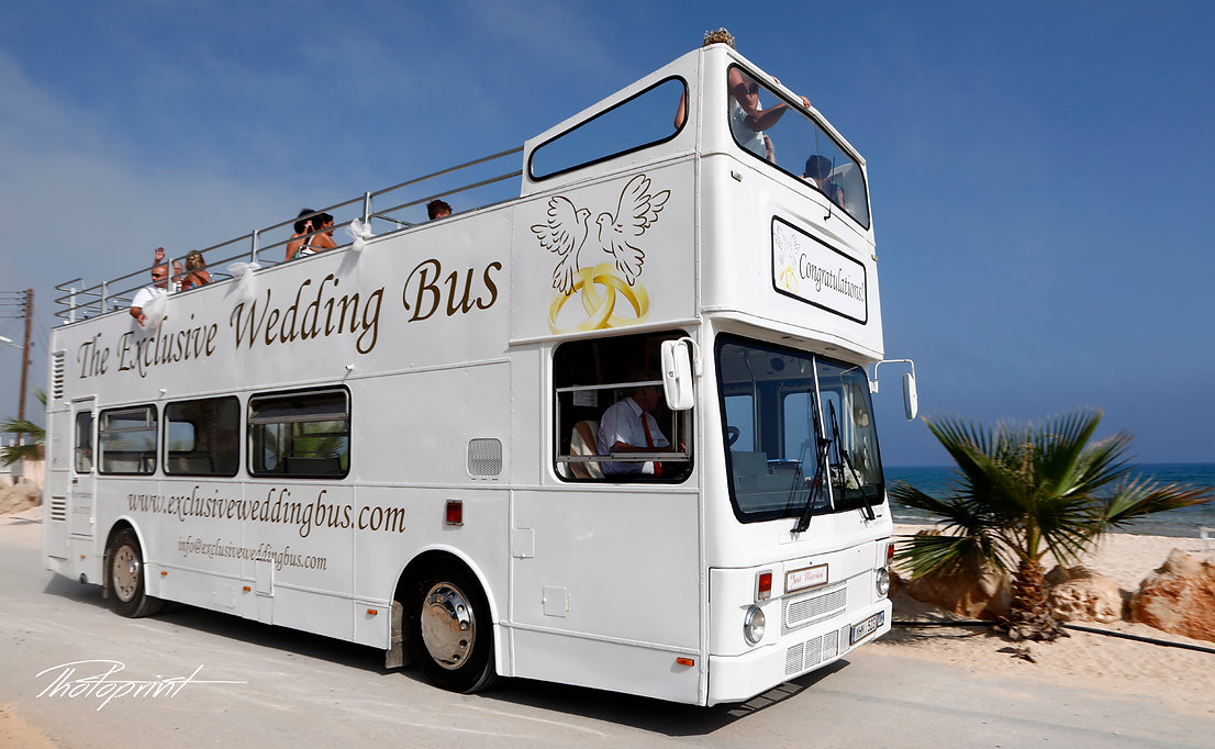 photo of the white wedding bus transports the guests and the bride to the wedding ceremony | best wedding venues ayia Thekla  cyprus, cyprus wedding photography best prices ayia Thekla,agia thekla beach wedding photography cyprus