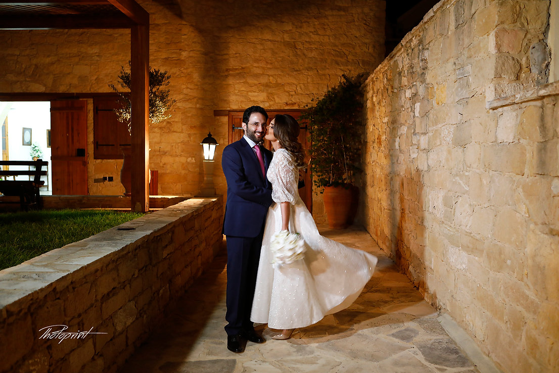 Beautiful and gentle wedding photo session outdoors of the elegant couple, bride in a white dress holding a bouquet and groom in the classic costume, family romantic portrait  | wedding photographer inYermasoyia cyprus, Yermasoyia cyprus wedding package for lebanese weddings