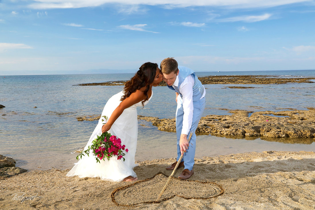 kissing Picture of romantic young couple on the sea shore | best cyprus wedding photographers