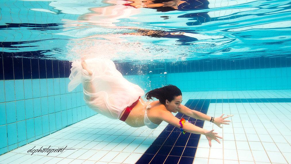 Portrait of beautiful bride and groom underwater in pool | wedding in ayia napa underwater photography,underwater wedding photographer cyprus