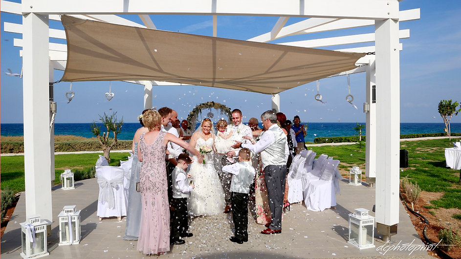 Bride and Groom in confetti shower after the wedding | protaras wedding photography photographer,  civil weddings in protaras  photography