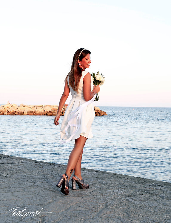 Beautiful bride in wedding dress and bridal bouquet,  on photo session outdoors | cyprus sunset images limassol wedding photography, cyprus wedding photography limassol
