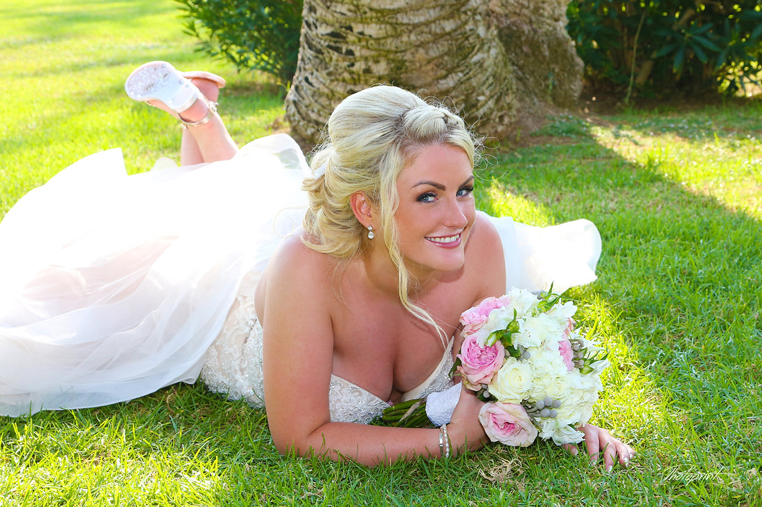 Happy bride Close-up portrait of gorgeous beautiful bride in white dress with amazing hair style and make up, with bouquet of flowers at Nissi beach resort in ayia napa, Cyprus  | wedding, bride, flower, human hair color, photograph, nissi beach, nissi beach hotel, ayia napa