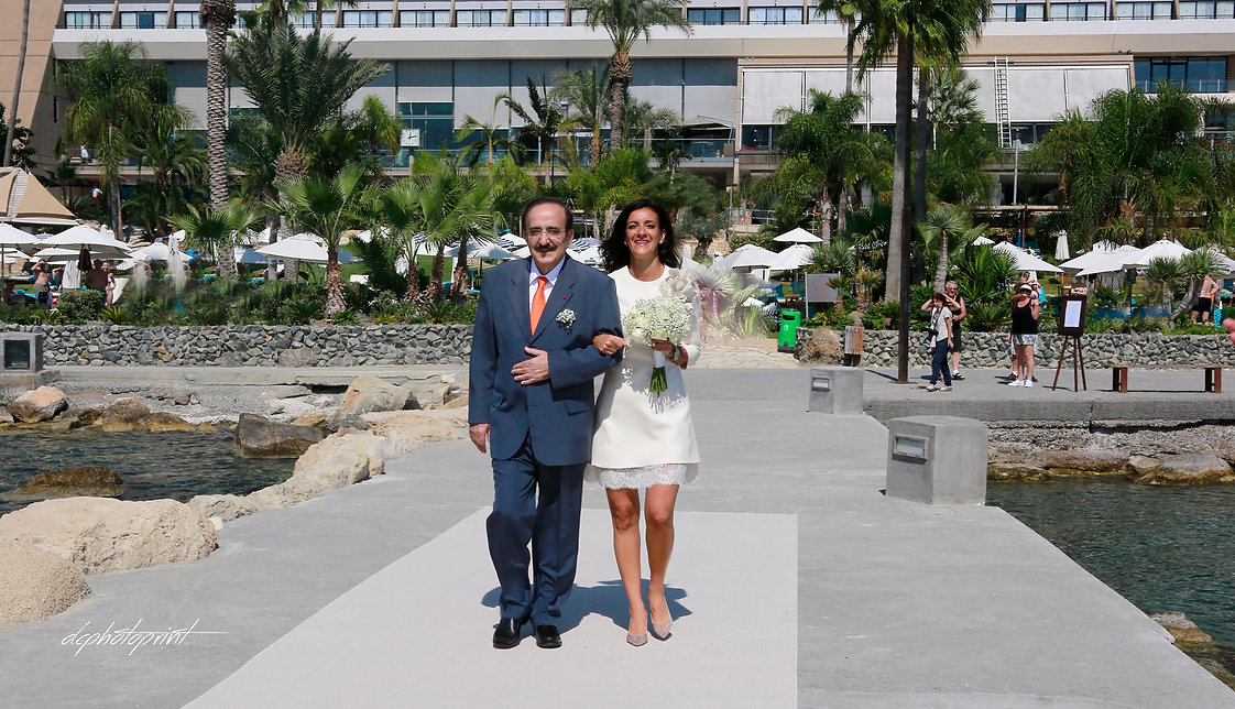 The bride comes accompanied by her father in the marriage | wedding photographer limassol, cyprus wedding photography best prices