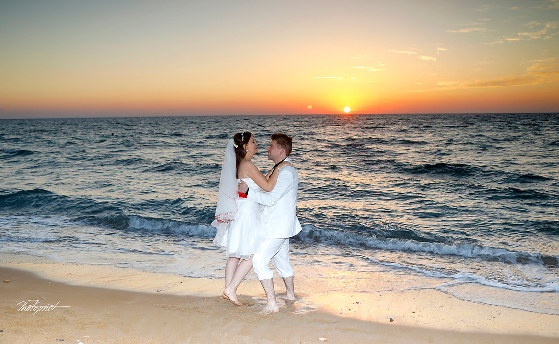 Bride and Groom, Kissing at Sunset on a Beautiful Mediterranean Paphos Beach | married in paphos municipality cyprus, photographer in Paphos, cyprus wedding photographer paphos, cyprus wedding photographers Paphos