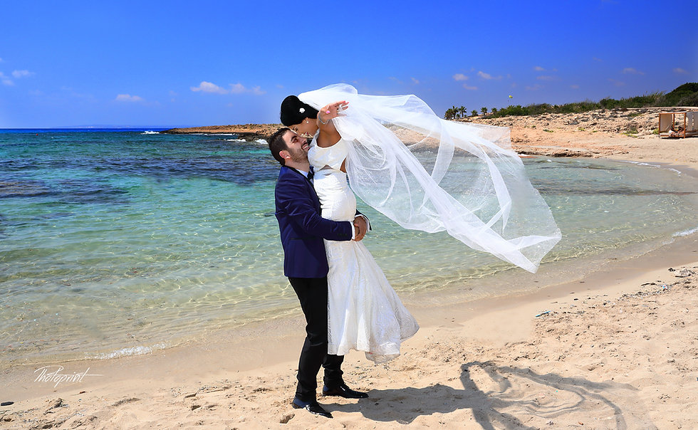 wedding celebration outdoors guests with the newlyweds after wedding at Ayia Napa.