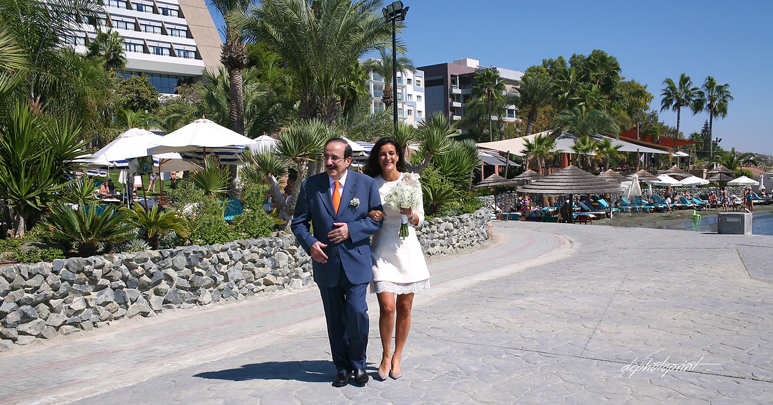 The bride comes accompanied by her father in the marriage | limassol wedding photography venues, cyprus limassol photographer paphos