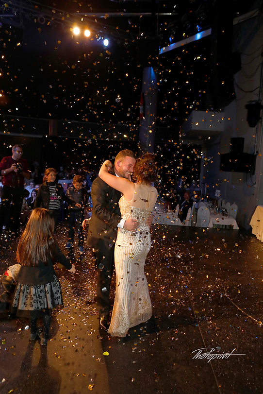 Portrait of confetti flying at dancing beautiful bride and groom  |  cyprus professional photographers nicosia, cyprus nicosia photographers,  nicosia photographers cyprus | photoprint cyprus, cyprus nicosia photographers | photoprint  cyprus,  nicosia wedding photo |  photoprint cyprus.