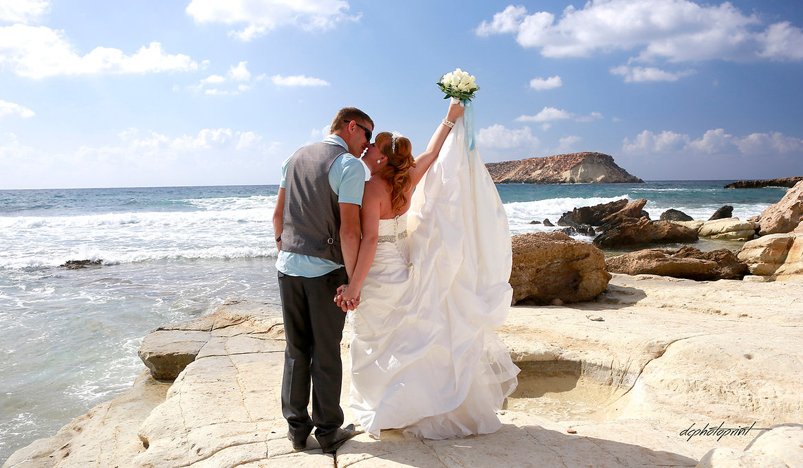 Picture of romantic young couple having a walking on the sea shore | photography prices photographers cyprus, famous wedding pics photographers Paphos