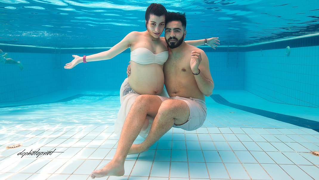 Portrait of beautiful bride and groom underwater in pool | wedding in ayia napa underwater photography,underwater wedding photographer cyprus