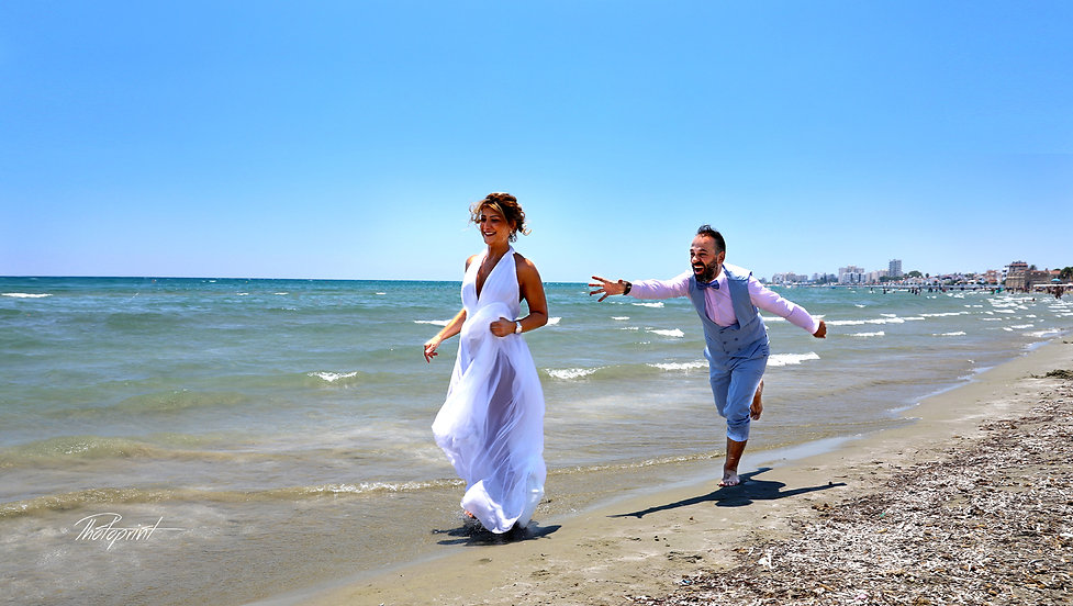 Happy just married young wedding couple celebrating and have fun at beautiful beach at Larnaca. cyprus wedding photographer