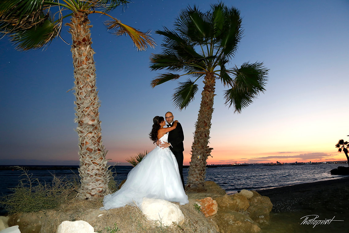 Wedding couple holding hands on sunset and kissing | Larnaca wedding photography prices cyprus, wedding photography larnaca, wedding photographers larnaca cyprus