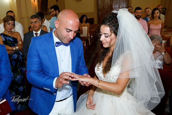 The groom wears the ring bride |  wedding photography prices cyprus , paphos lebanese wedding photography , lebanon wedding photographers protaras