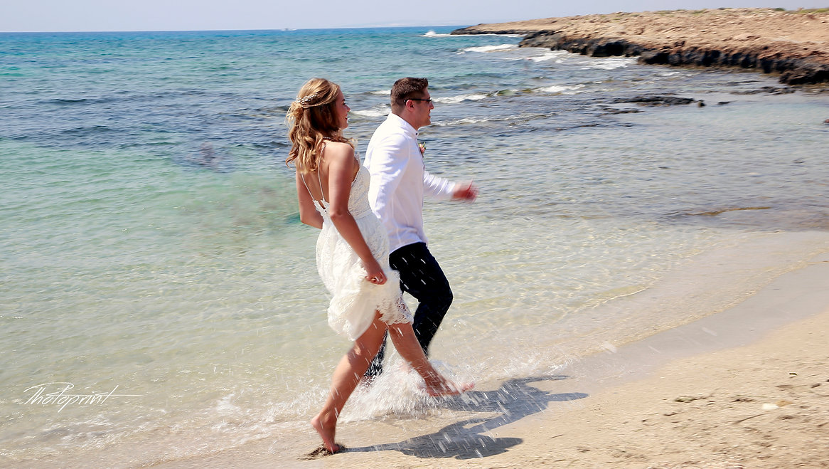 Couple running on ayia napa beach holding hands smiling |  ayia napa wedding packages cyprus, ayia napa wedding packages in cyprus, ayia napa wedding photo prices