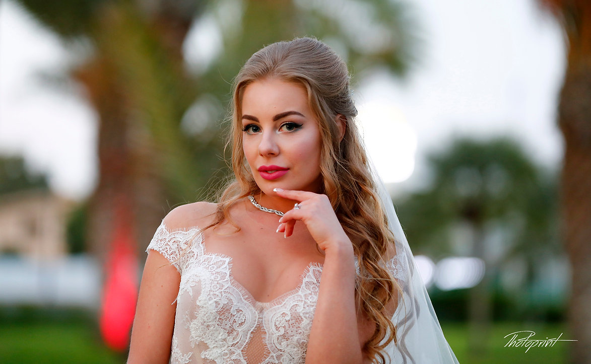 Gorgeous bride in wedding dress with bouquet of flowers posing by the sea | wedding photography prices larnaca cyprus, wedding photography prices cyprus,wedding photography larnaca