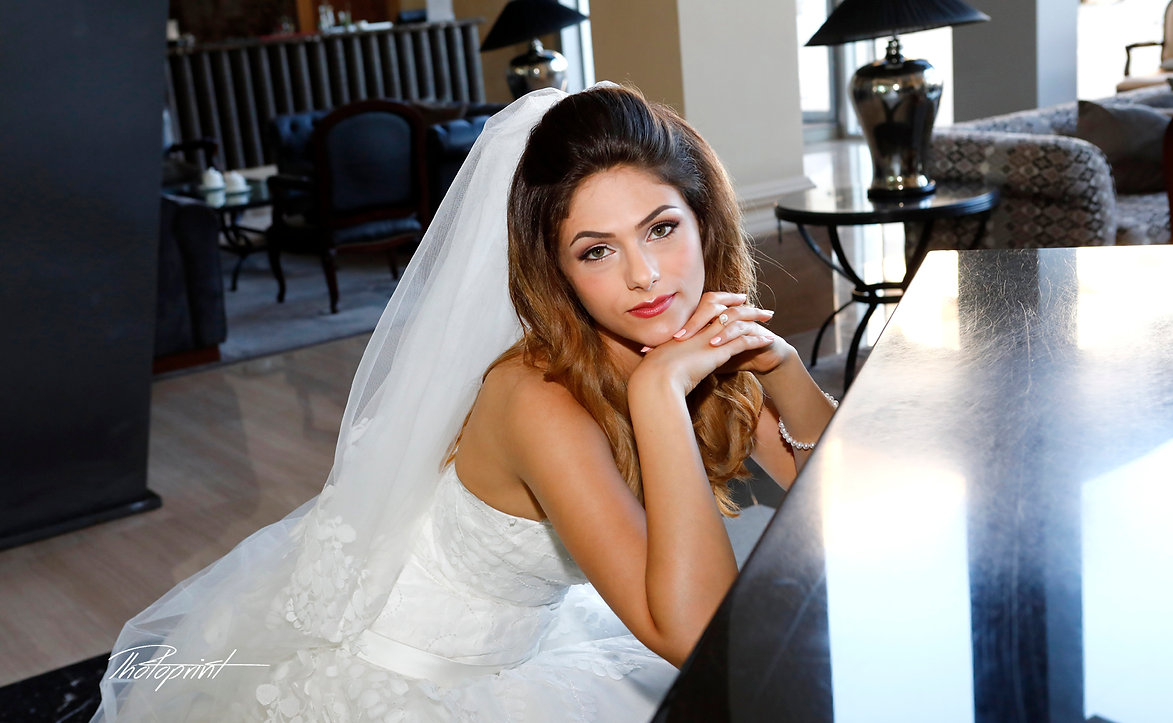 Portrait of beautiful young bride ( Mireille ) in a luxurious lace wedding dress. She sits on a black piano indoors in Grecian Park Hotel at Protaras, cyprus | wedding protaras venues cyprus, weddings photographer protaras, wedding protaras photography cyprus