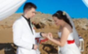 Celine Put the Wedding Ring on Michel finger in the wedding ceremony   cheap but good wedding photographers Paphos, cheap wedding photographer Paphos, cheap wedding photographers paphos