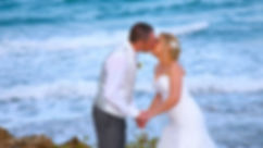 Bride and groom Kissing outdoors at the park near the Pernera beach Hotel in Protaras. Blue Beautiful  Mediterranean Sea on background | wedding protaras photographers, cyprus wedding Protaras photography best prices