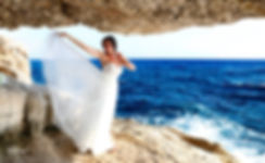 Gorgeous bride in wedding dress posing in Cavo greco beach. Blue Mediterranean Sea on background | Cape Greco Protaras Wedding - dcphotoprint, Cape Greco for a romantic wedding,  Cape Greco wedding photographer,  Cape Greco wedding photography