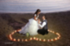 the bride and groom in moments of love, surrounded by candles in heart shape