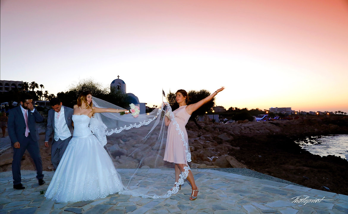 Happy just married young wedding couple celebrating and have fun at beautiful beach sunset   professional wedding photographers cyprus