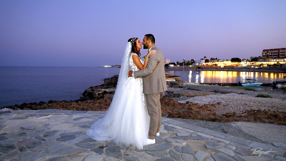 Bride and groom by the sea kissing | wedding  photographer packages in cyprus