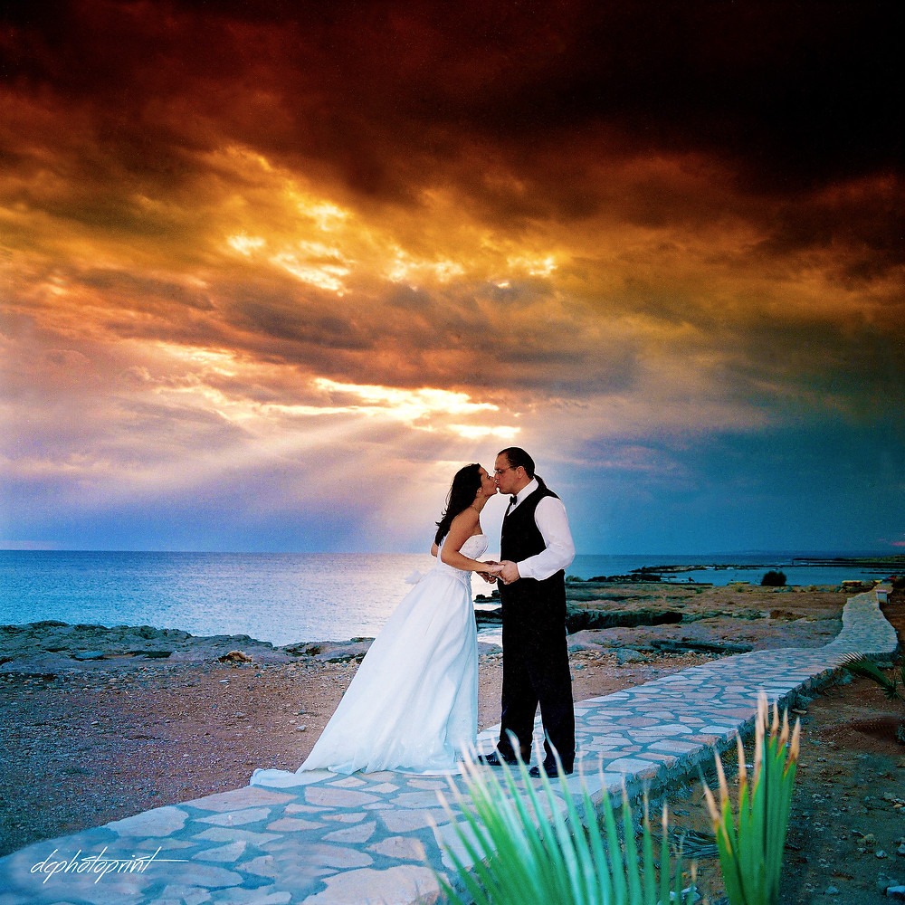 Bride and Groom, Kissing at Sunset on a Beautiful ayia napal Beach