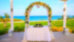 Wedding on the beach. Wedding arch decorated with flowers on Mediterranean sand beach | cyprus protaras sunset images wedding photography, weddings photographer protaras