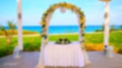 Wedding on the beach near Pernera beach Hotel decorated with flowers on Mediterranean sand beach |  weddings photographer protaras, weddings photographer protaras