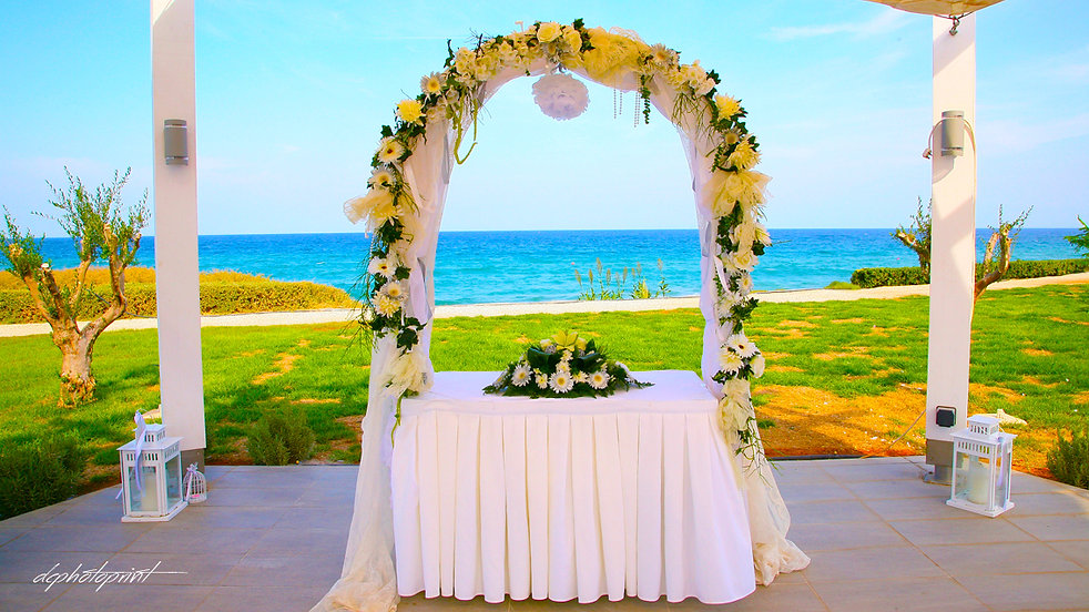 Wedding on the beach near Pernera beach Hotel decorated with flowers on Mediterranean sand beach |  weddings photographer protaras, weddings photographer protaras