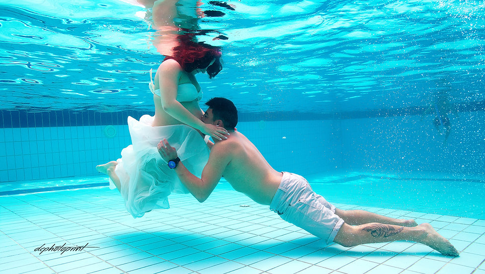 Happy just married young wedding couple underwater holding hands and Kissing | underwater  photography in paphos cyprus, amous wedding pics photographers Paphos