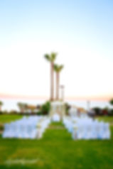 Beautiful  Wedding arch decorated with flowers on tropical sand beach, outdoor at Amathus Beach Hotel, Limassol cyprus | best wedding venue limassol, wedding photography ideas limassol venues cyprus