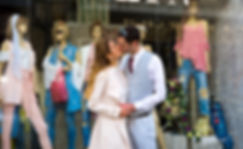 Elegant smiling bride and groom walking on the street, kissing | wedding venues paphos, cyprus weddings paphos, wedding photography photos