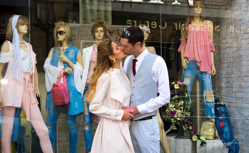 Elegant smiling bride and groom walking on the street, kissing  | wedding portfolio