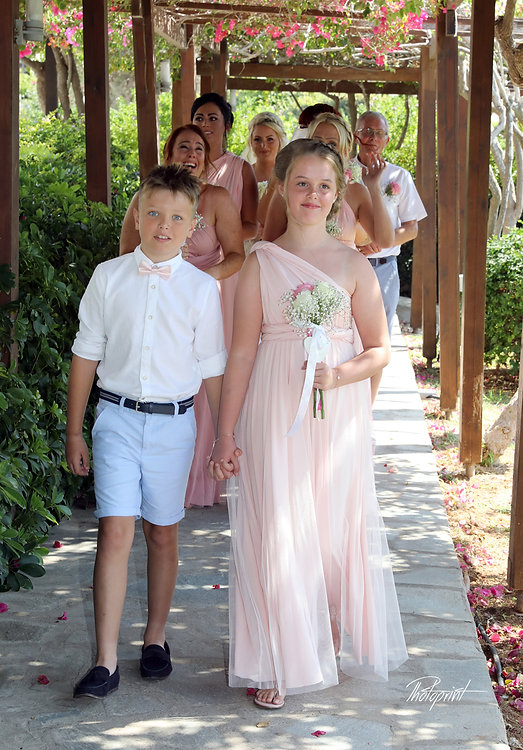 Guests and the bride walk for the wedding ceremony | Ayia Napa Weddings - Nissi Beach Resort