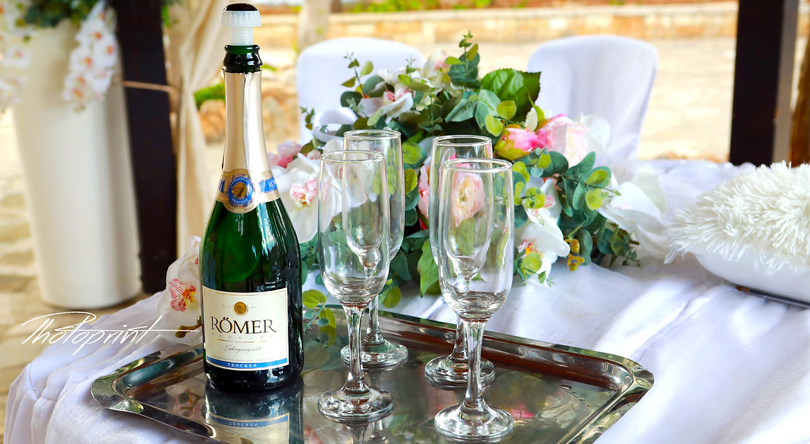 Champagne bottles and glasses decoration for wedding day with flowers on background  | marriage at city hall paphos,  paphos photographers cyprus, top wedding photographer cyprus