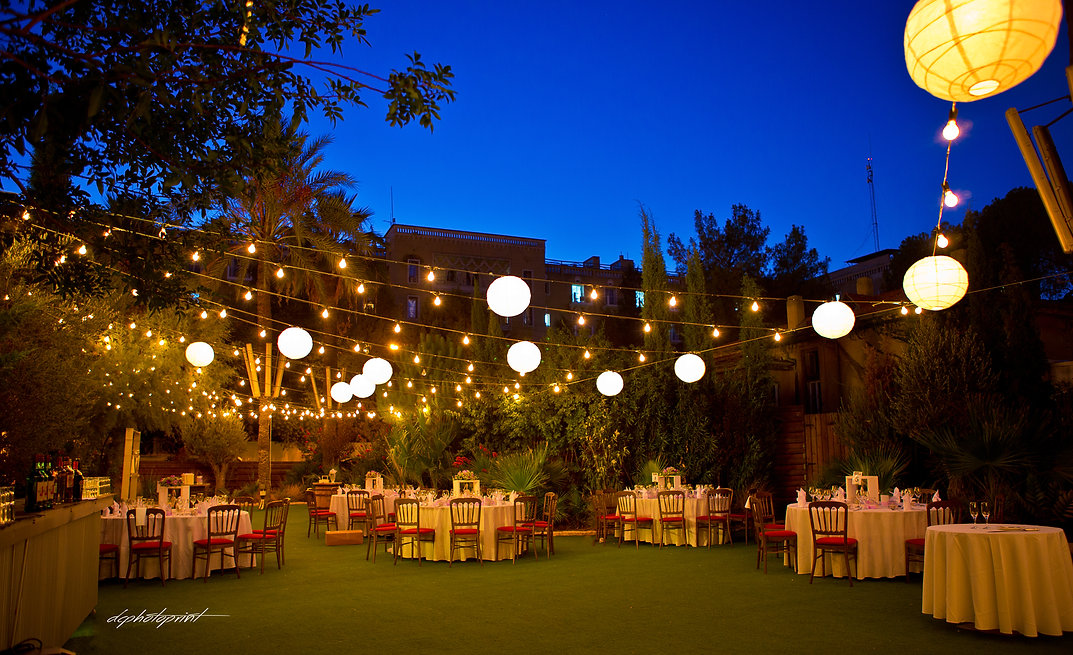 outdoors at night, Beautiful wedding reception  with round tables and floral | city town hall marriage at ayia napa, cyprus ayia napa wedding photography  cost