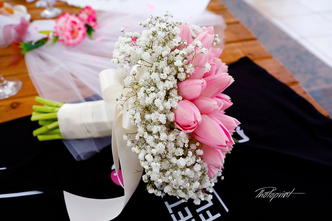 The beautiful bridesmaid bouquet on the table ready for the wedding | beach wedding in Protaras cyprus | bridal Protaras photography, budget wedding photographer protaras, Protaras cheap but good wedding photographers