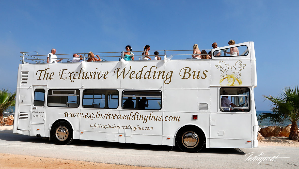 picture of the white wedding bus transports the guests and the bride to the place of the wedding ceremony | budget wedding photographer cyprus, cheap but good wedding photographers cyprus,cheap wedding photographer cyprus