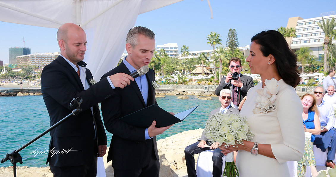 Groom  swearing lifetime loyalty the wedding ceremony  in Amathus  Beach Hotel, Limassol cyprus.  magnificent Mediterranean Sea in the background | wedding limassol photographers cyprus, wedding photography limassol