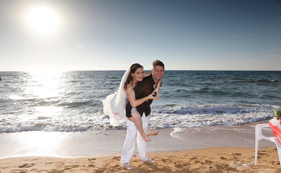 Couple in love piggyback playing in a lemba Paphos beach at blue Mediterranean | cyprus wedding photographer paphos, Paphos wedding photographers, cyprus wedding photography, best cyprus wedding photos