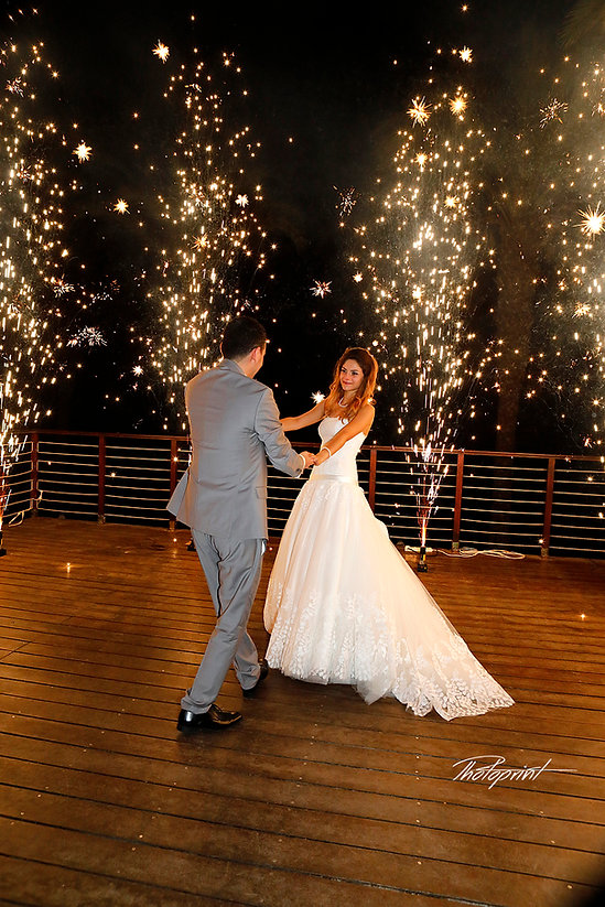 Newly married couple dancing on their wedding party background heavy beautiful fireworks with lots of stars   cyprus protaras wedding photography  cost, protaras  best wedding photography,wedding photographers protaras
