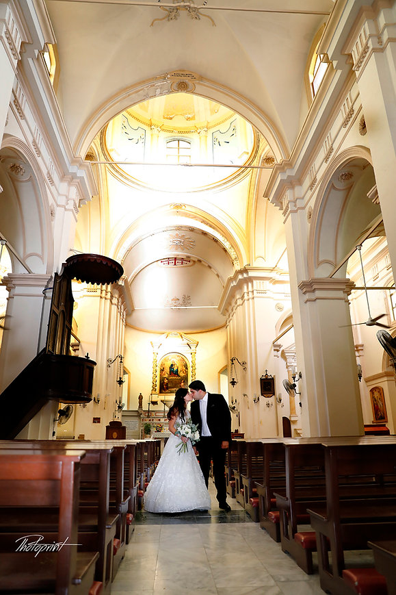 Young couple just married inside of church kissing | cyprus wedding photographers, larnaca lebanese Wedding Photographers