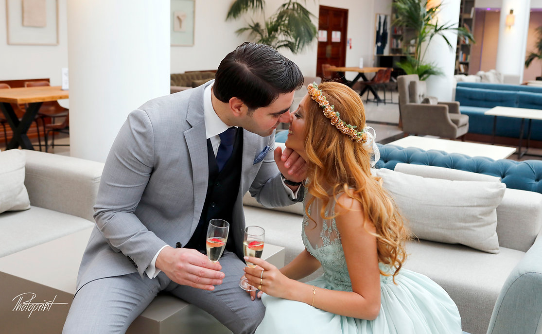 Elegant beautiful Just married couple holding champagne glasses | professional wedding photographers nicosia cyprus, professional wedding photographers nicosia, professional wedding photography nicosia