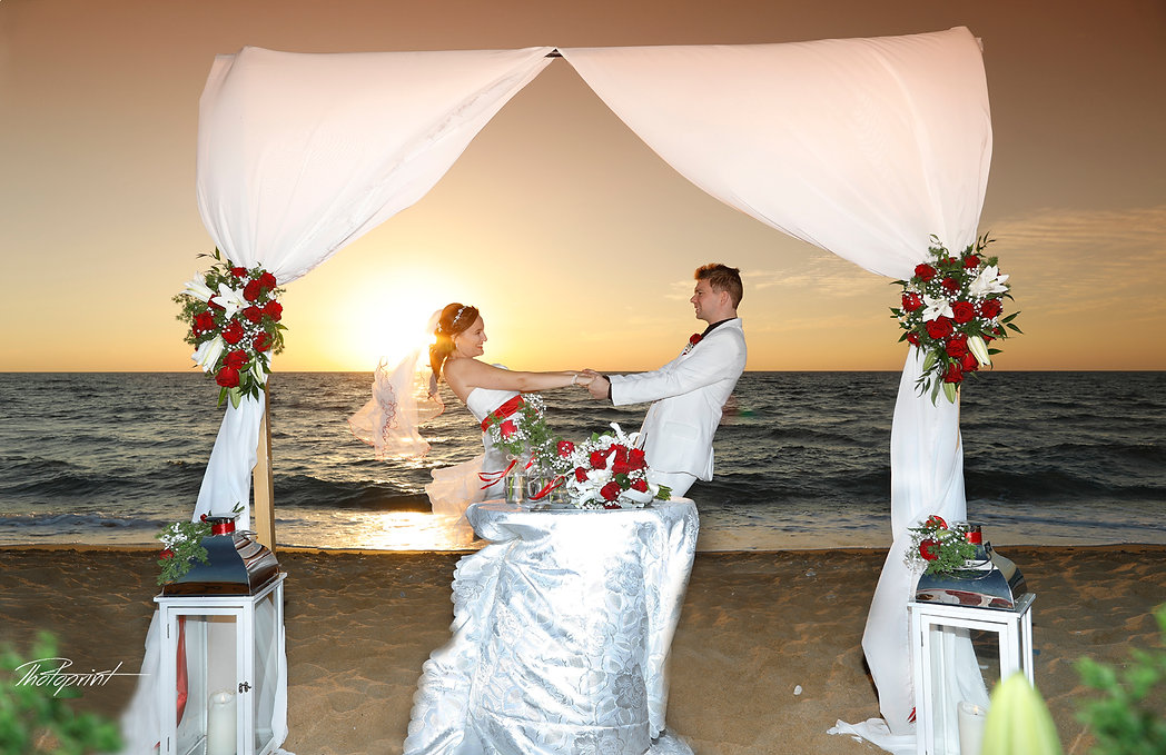 Happy just married young wedding couple celebrating and have fun at beautiful beach sunset | wedding photographer cost in Paphos, Paphos beach hotels wedding photography, wedding packages in Paphos,wedding venues in Paphos, wedding venues in Paphos cyprus