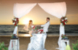 Happy just married young wedding couple celebrating and have fun at beautiful beach sunset   wedding photographer cost in Paphos, Paphos beach hotels wedding photography, wedding packages in Paphos,wedding venues in Paphos, wedding venues in Paphos cyprus