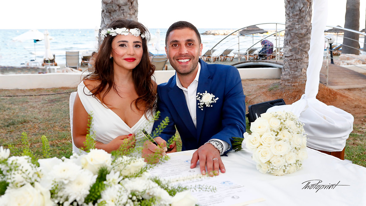 Happy young Groom signing wedding registration form in Golden Bay Beach Hotel, Larnaca | cyprus wedding larnaca photographers near, cyprus wedding larnaca photographers websites