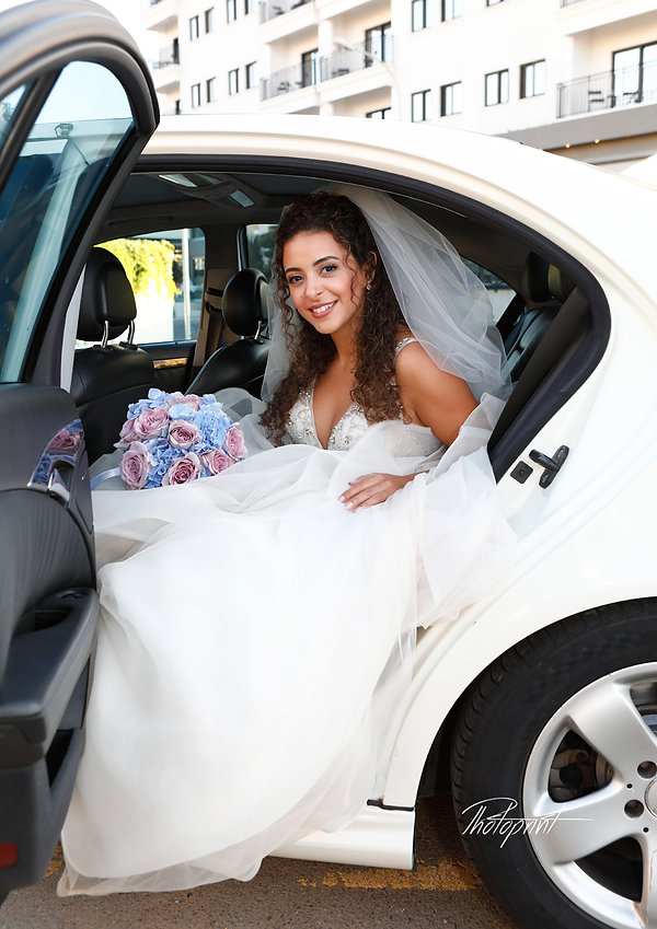 the bride is ready at the limousine for the wedding in the church | larnaca civil wedding photographer , larnaca civil weddings photographers, larnaca civil weddings photographers